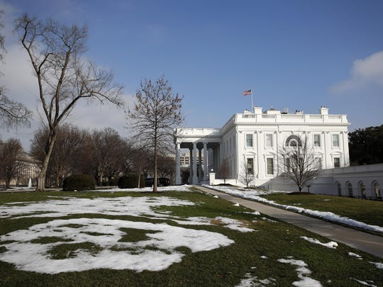 Snow begins to melt on the North Lawn of the White House, Friday, Jan. 18, 2019, in Washington. (AP Photo/Jacquelyn Martin)