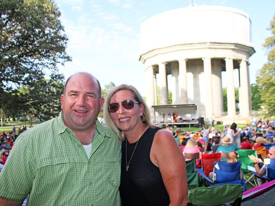 Des Moines City Councilman Chris Coleman, seen with his wife, Marcie, at a Beaverdale Bluegrass Festival in Des Moines, won't be seeking a sixth term.