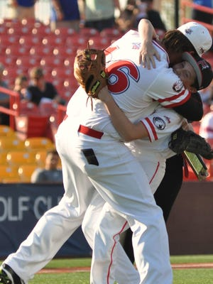 Florence Freedom player Isaac Wenrich reacts to seeing Nate Boyer of Chandler, Arizona, who is credited with saving his life after a heart attack earlier this year. The reunion happened during the Florence Freedom game held Friday, June 10, at UC Health Stadium.