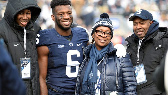 Senior safety Malik Golden said he has gained his football strength from his mother (right) who beat breast cancer and his younger brother, Elijah II, (left) who was hospitalized for months after complications from scoliosis surgery. Here, the family, including father, Elijah, gathers on Penn State senior day.