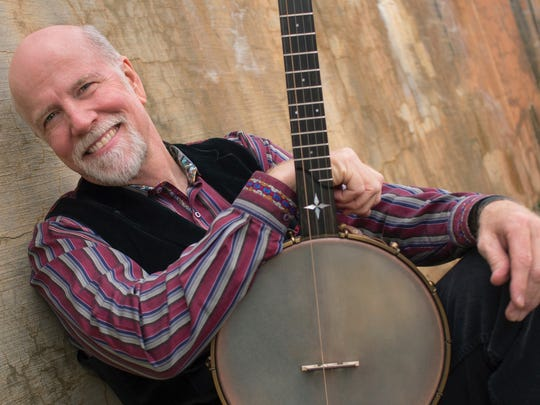 John McCutcheon will perform with the College of St.