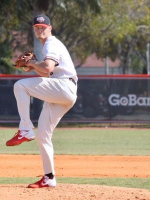 Barry University's Myles Gayman goes through his pitching delivery during a college baseball game.