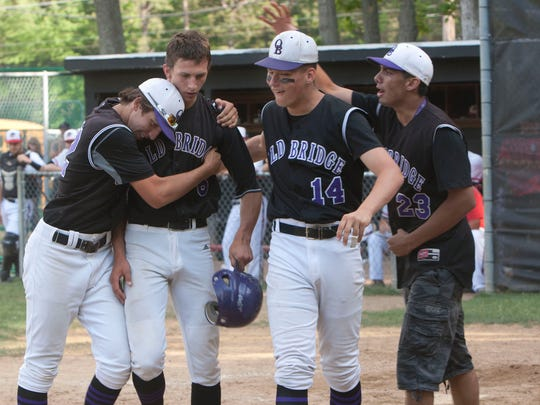 5/26/15 - Old Bridge's Tyler Hopman (2nd from left) is congratulated by teammates after he hit a game tying Home Run in the 6th inning during  NJSIAA Group 4 Semi final baseball game.