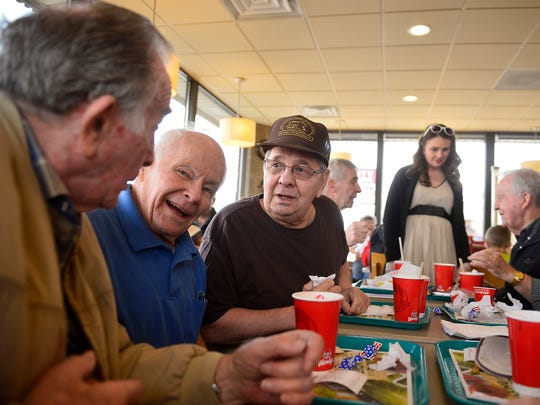 From left: Harold McElroy, Chuck Hackman and Howard Gusaas talk over lunch at Wendy's on Friday afternoon. Their lunch group they call the Retired Old Men Eating Out club or the ROMEO club, has been meeting for several years.