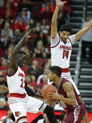 Louisville's Deng Adel, left, and Anas Mahmoud trapped SIU's Aaron Cook in the backcourt. Nov. 21, 2017.