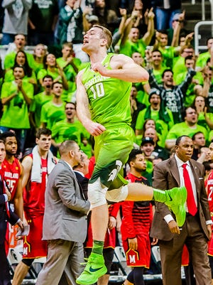 Matt Costello ,10, of MSU leaps in the air in celebration after blocking a Maryland shot attempt with 18 seconds  remaining in their game Saturday in East Lansing.