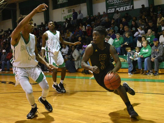 Fair Park's Jeremy Johnson moves the ball at the Bossier Invitational boys basketball tournament championship game.