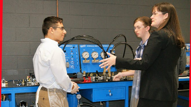 State Commissioner Candice McQueen visits the Mechatronics program at Fairview High School.