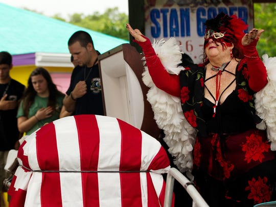 Buzzard Lope Queen Mary Martin stands near the casket