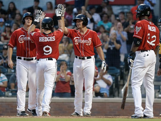 El Paso catcher Austin Hedges is met at home plate by teammates Alex Dickerson, left, and Hunter Renfroe after this three-shot homer Friday against Salt Lake at Southwest University Park. Read about the game at elpasotimes.com