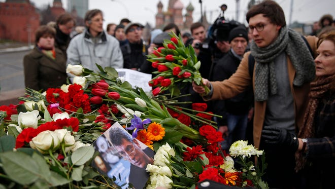 People lay flowers at the place where Boris Nemtsov was gunned down in Red Square in Moscow on Feb. 28, 2015.
