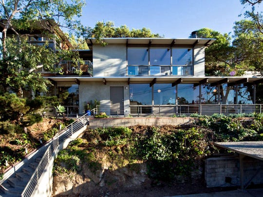 Los Angeles mayor Eric Garcetti and his wife, Amy Wakeland, bought the Daniel L. Dworsky-designed home in the Echo Park neighborhood more than a decade ago for $345,000. The multi-level post-and-beam features polished concrete floors, walls of floor-to-ceiling glass and grounds of more than half an acre. (Michael McNamara/Shooting LA/TNS)