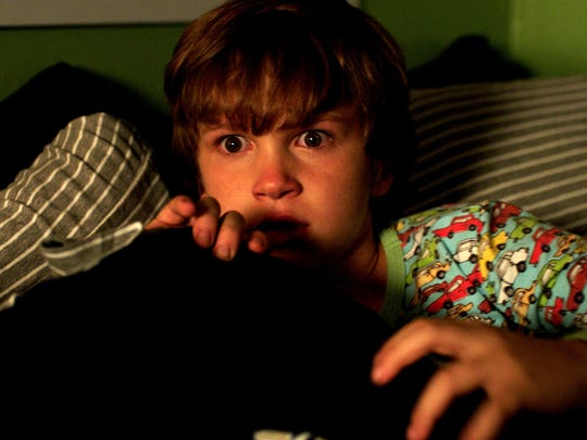 "Gabriel Bateman in ""Lights Out."" The movie opens Thursday"