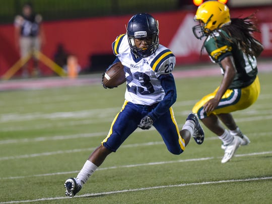 Theontae Allen runs the ball at The Kiwanis Football Jamboree as Cecilia takes on Carencro.