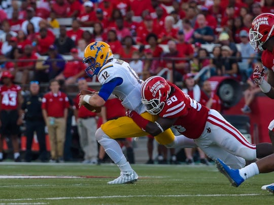 Trev Miller gets the sack on quarterback Grant Ashcroft as the Cajuns take on McNeese for the second game of the season. September 10, 2016.