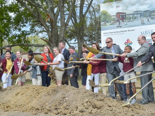 Ground breaking ceremonies by school and school board