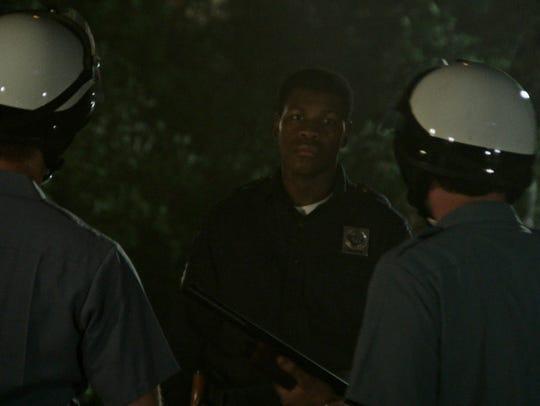 "John Boyega in a scene from ""Detroit."" The movie opens"