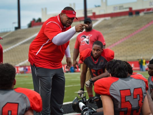 Northside coach John Simmons makes a point to his players