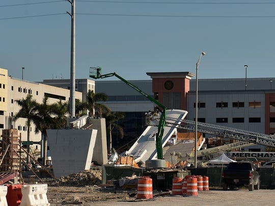 A brand new, 950-ton pedestrian bridge collapsed in front of Florida International University, Thursday, March 15, 2018, in Miami. Florida officials said Thursday that several people have been found dead in the rubble of a collapsed South Florida pedestrian bridge where the frantic search for any survivors continued past nightfall. (Michael Laughlin/South Florida Sun-Sentinel via AP)