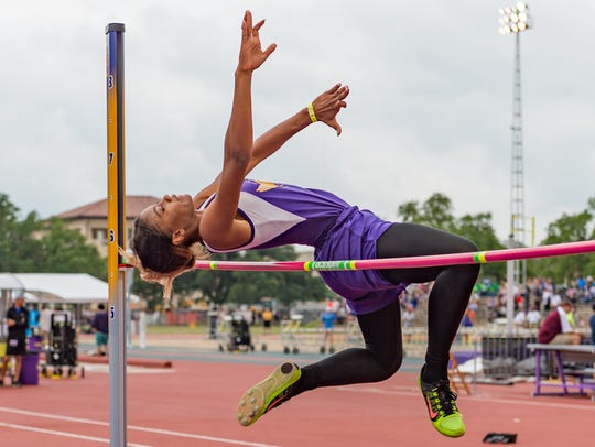 Jordan Landry competes in the girls high jump at the