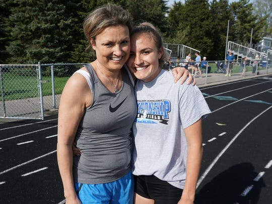 Angela Hill (Dugas) '85 poses with her daughter Allyson Hill, a 2017 graduate of Ladywood.
