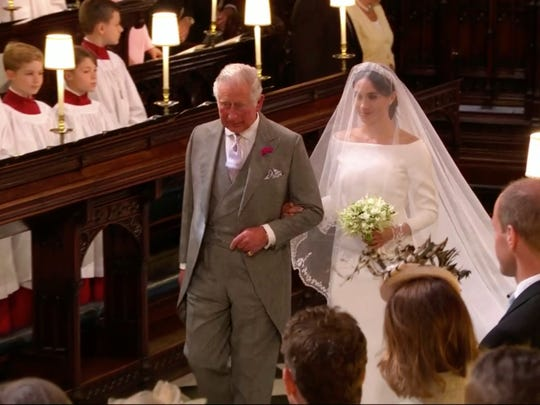 In this frame from video, Meghan Markle walks down the aisle with Prince Charles for her wedding ceremony at St. George's Chapel in Windsor Castle in Windsor, near London, England, May 19, 2018.