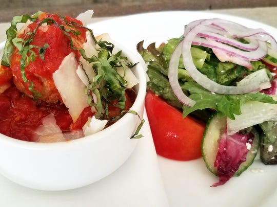 Meatballs and house salad are on Campiello's two for