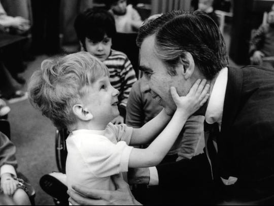 "Fred Rogers connects with a young fan in the documentary ""Won't You Be My Neighbor?"""