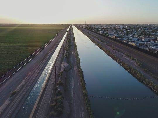 The All-American Canal runs along the U.S.-Mexico border outside Mexicali, bringing Colorado River water to the farm fields of California's Imperial Valley.