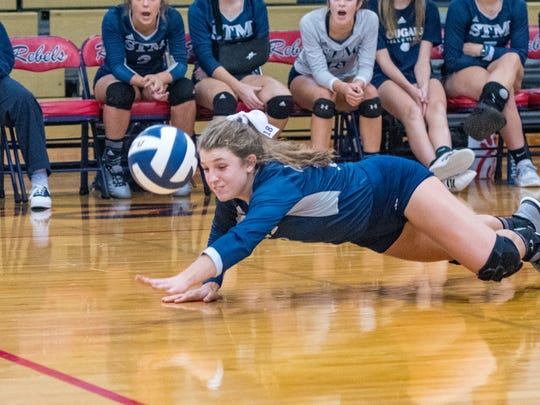 Meredith Howard digs a ball at the Teurlings Catholic  Volleyball Jamboree. Wednesday, Aug. 22, 2018.