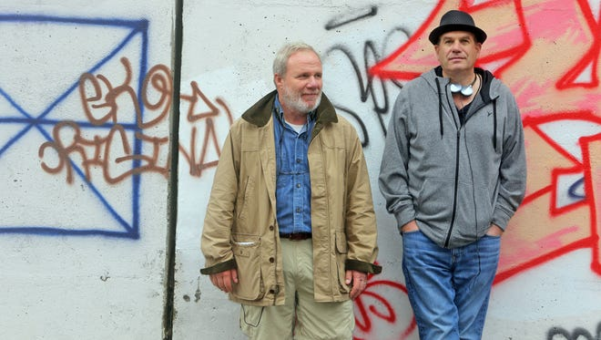 """Co-writers and producers Bill Zorzi, left, and David Simon at the Schlobohm Houses public housing project in Yonkers in October. The Schlobohm Houses is one of the locations used for filming of the HBO mini-series """"Show Me a Hero,"""" which will air in August."""