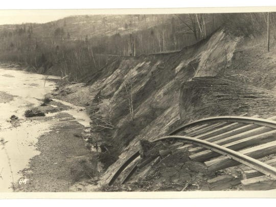 A view of Winooski River damage at Bolton after the 1927 flood. Learning to live next to rivers in ways that both support human infrastructure and land use while still protecting floodplains, which assuage flood damage and protect water quality, is a challenge faced by Conservation Districts.