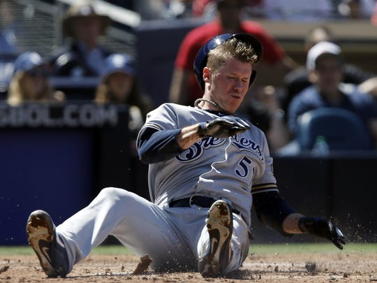 Milwaukee Brewers' Chase Anderson lands awkard as he scores on a basehit by Christian Yelich against the San Diego Padres during the third inning of an opening day baseball game in San Diego, Thursday, March 29, 2018.  Anderson went six innings and allowed just one hit and no runs in a win. He starts again Tuesday against the Cardinals.