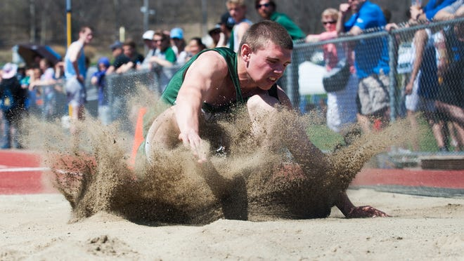 A jumper enters the long jump pit at the Burlington Invitational track and field meet earlier this month.