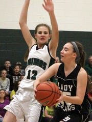 Jordyn Dempsey, right, drives toward the basket while being defended by Animas' Tierney Washburn on Friday afternoon.