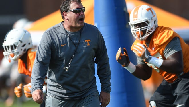 Brady Hoke, Tennessee's new defensive line coach, runs a drill on the first day of spring practice March 21, 2017.
