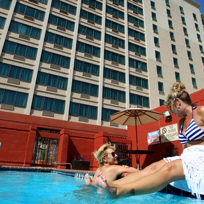 July 9, 2015 - JoAnne Hupt (left) and Susan Hillker relax by the pool outside the Crowne Plaza Memphis Downtown on Second Street. The hotel just completed a $7 million renovation. (Mike Brown/The Commercial Appeal)