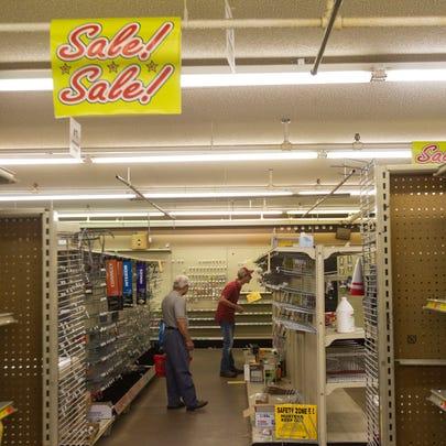 Customers shop inside Paul's on Saturday, July 14,