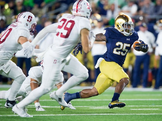 Running back Tarean Folston (25) and the Irish travel