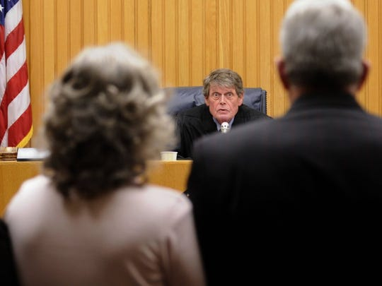 Raynella Dossett Leath listens as Judge Richard Baumgartner sentences her to life in prison for the murder of her husband, David Leath, on Monday, Jan 25, 2010, in Knox County Criminal Court.