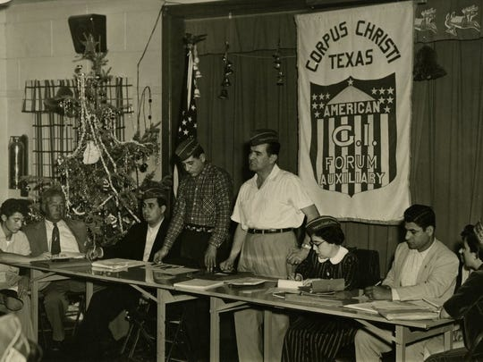 CONTRIBUTED PHOTO Dr. Hector P. Garcia (center in white) presides over a meeting of the Corpus Christi chapter of the American GI Forum. The photo is part of his official papers.
