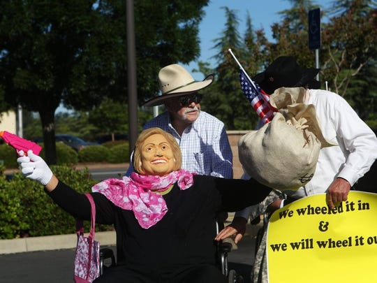Andreas Fuhrmann/Record Searchlight The Asphalt Cowboys held their pretend bank robbery Monday at Plumas Bank on Hilltop Drive kicking off the 68th annual Redding Rodeo