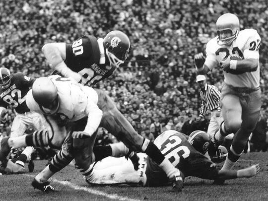 Notre Dame's Dave Haley carries the ball against Michigan State on Nov. 19, 1966 in East Lansing.. Notre Dame coach Ara Parseghian chose to run the ball rather than risk passing late in the defense-dominated 10-10 tie.