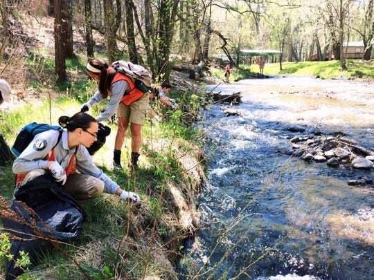 In this 2016 Ruidoso News file photo, volunteers pickup debris along the river bank at the 2016 Keep Ruidoso Beautiful.