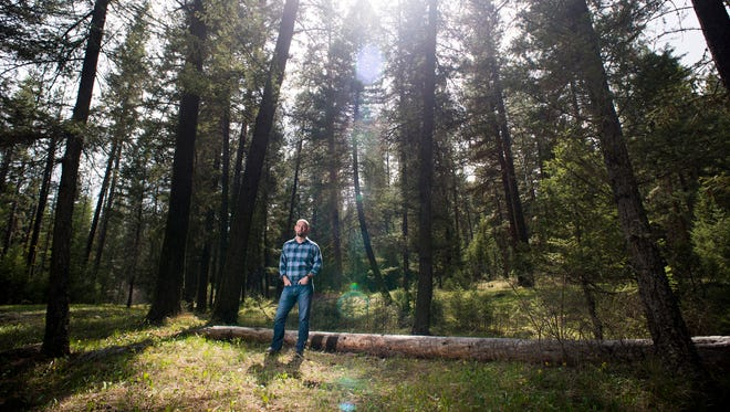 Martin Nie, director at Bolle Center for People and Forests and professor of natural resources policy at the University of Montana, says if federal land is turned over to states it will open the flood gates. He stands near the main Rattlesnake National Recreation Area and Wilderness trailhead north of downtown Missoula,