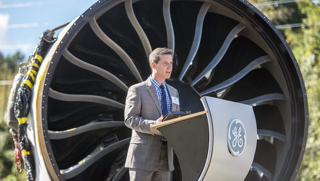Michael Meguiar of GE, speaks at the grand opening of GE Aviation's new plant in South Asheville Oct. 15, 2014. State and local official offered the company an incentives package to attract them to North Carolina and  Buncombe County.