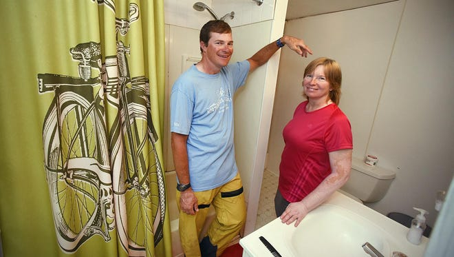 Brian and Dena Squire, of Fort Collins, Colorado, stopped July 20 in Bowlus. Jan Lasar and his wife Jen open their home to passing cyclists as part of the Warm Showers program.