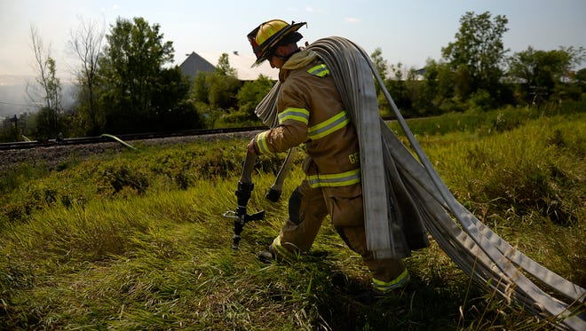 Green Bay Mayor Jim Schmitt has proposed eliminating four vacant firefighter positions in order to save an estimated $400,000.