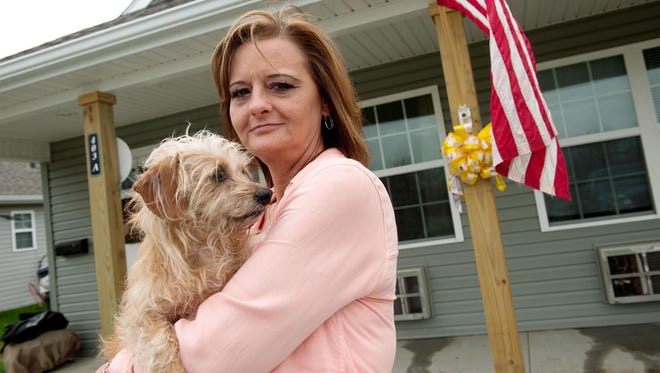 After several months of living in her car with her dog Izzabella, Lisa Woody has found a home at Patriot Park, a veteran housing complex for homeless veterans completed late last year in Carterville. The complex has 12 units, and all but four are rented.
