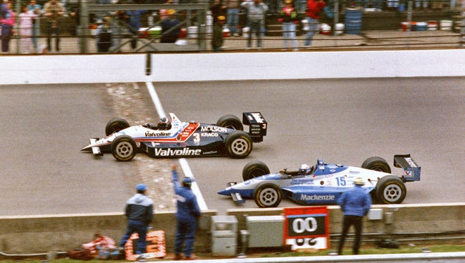 Al Unser Jr. (No. 3) races across the finish line ahead of Scott Goodyear (No. 15) in the closest finish of the Indianapolis 500 on May 24, 1992. Unser's margin of victory was 0.043 seconds.